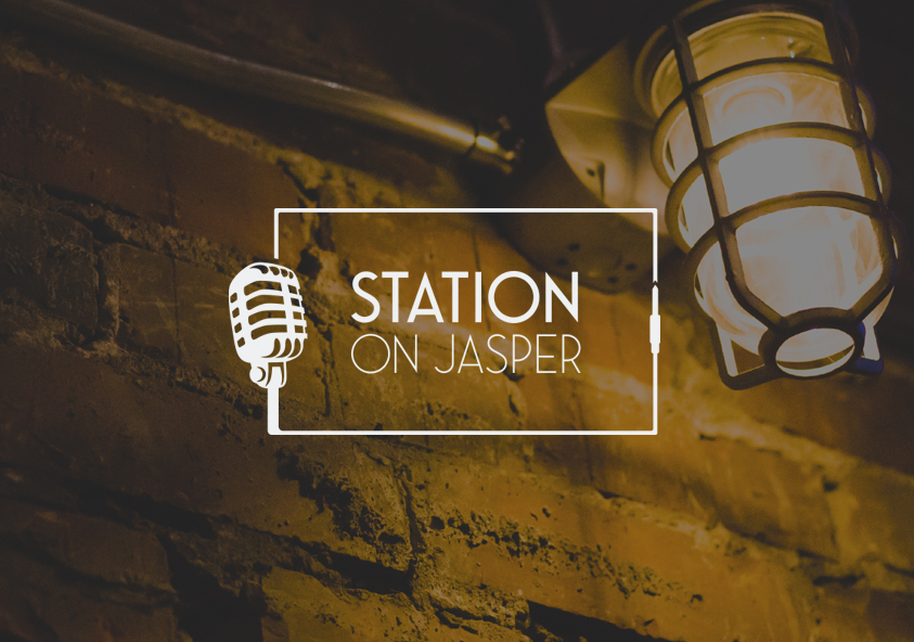 Station On Jasper logo over brick wall background - SAVIAN, Edmonton Digital Marketing